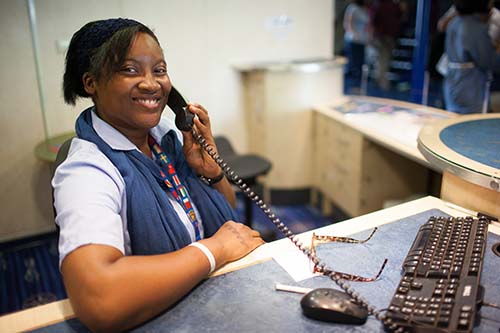 Incheon, South Korea :: Eileen Rijke (Curacao) works at service desk.